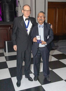 Tipu Aziz receiving SBNS medal from the president Neil Kitchen